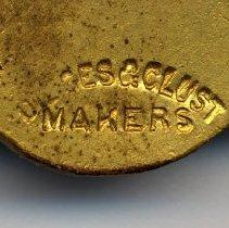 Image of detail back of medal: marker's mark