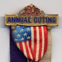 Image of full ribbon badge or pin
