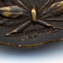 Image of detail reverse: maker's mark