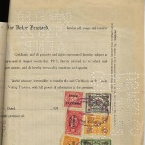 Image of rear of certificate with stock transfer stamps; inkstamps