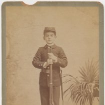 Image of Cabinet photo of ca. 8-10 years old boy posed in military uniform with rifle in a studio, Hoboken, n.d., ca. 1892-1900. - Photograph, Cabinet