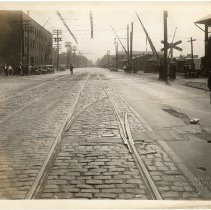Image of B+W photo looking south on Willow Ave. & 17th St.; streetcar tracks & freight rail crossing, Hoboken, n.d., (1927). - Print, Photographic