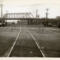 Image of B+W photo looking east across Willow Ave. along 17th St.; streetcar tracks & freight rail crossing, Hoboken, n.d., (1927). - Print, Photographic