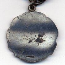 Image of back of medal; detail mark of C.G. Braxmar Co., N.Y.