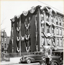 Image of B+W photo of Knights of Columbus clubhouse decorated for 40th anniversary, 716 Hudson St., Hoboken, 1936. - Print, Photographic