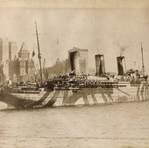 Image of Sepia tone photo of troopship U.S.S. Leviathan on Hudson River nearing the Battery, n.d., ca. March - Dec. 1918.  - Print, Photographic