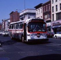 Image of Color photo of Red Apple New York-Hoboken bus on Washington St. at Newark St., Hoboken, May 17, 1987.  - Transparency, Slide
