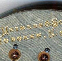 Image of detail back, bottom, maker's mark: G. Meiners & Son, Hoboken, N.J.
