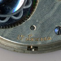 Image of detail back, right side (rotated): 17 Jewels; note side winding stem hole