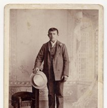 Image of Cabinet photo of young man posed in photographer's studio, Hoboken or Bergen Point, N.J., n.d., ca. 1895-1910. - Photograph, Cabinet