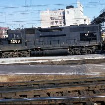 Image of Color slide photograph of diesel-electric locomotive in train yard, Hoboken, Jan. 25, 1981. - Transparency, Slide