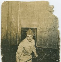 Image of photo 2: Michael Riccio in World War II Army uniform while playing pool