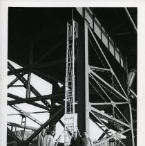 Image of B+W photo of load test on extension ladder performed by United States Testing Co., Hoboken, at south side of 14th St.Viaduct near Adams St. N.d., ca. 1970s or 1980s. - Print, Photographic