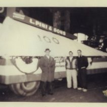 Image of B+W photos, 2, of L. Pini & Sons parade float with giant pipe wrench on trailer for March 28, 1955 Hoboken Centennial Parade. - Photograph