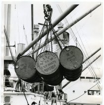 Image of B+W photo of drums of olive oil being unloaded from S.S. Exporter, American Export Lines, Hoboken, N.J., July 16, 1962. - Print, Photographic