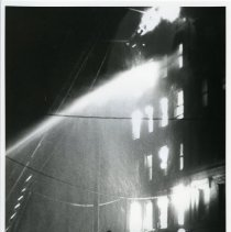 Image of B+W photo of firemen fighting a tenement fire at 121 Clinton St., Hoboken, Jan. 20, 1979. - Print, Photographic