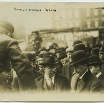 Image of Sepia-tone photo of former President Theodore Roosevelt examining his luggage at Hamburg-American Lines pier in Hoboken, March 22, 1909. - Print, Photographic