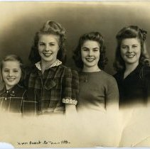 Image of Sepia-tone group portrait of 4 Stover family daughters of 1037 Bloomfield St., Hoboken, Christmas 1943.  - Print, Photographic