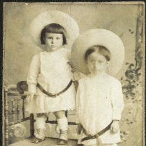 Image of Sepia-tone photo of 2 young children posed in studio, Hoboken, n.d., ca. 1890-1910. - Print, Photographic