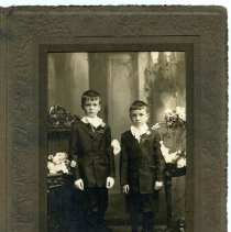 Image of Sepia-tone photo of 2 young boys posed in studio, Hoboken, n.d., ca. 1900-1920 - Print, Photographic