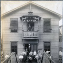 Image of Sepia tone photo of Atlantic Boat Club exterior with members, Hudson River between 4th & 5th Sts., Hoboken, n.d., ca. 1880s. - Print, Photographic
