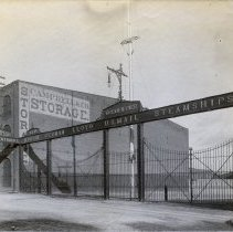 Image of Sepia tone photo of the North German Lloyd S.S. Co. entry gates, Bremen Pier, River St. near Third St., Hoboken, n.d., ca. 1890s. - Print, Photographic