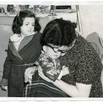 Image of B+W photo of Anna Scutellaro, wife of Joseph Scutellaro, with children, Marie & Joseph, Jr., in apartment kitchen, 611 Monroe St., Hoboken, N.J., Feb. 25, 1938.  - Print, Photographic
