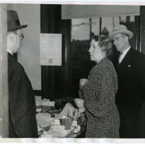 Image of B+W photo of Eleanor Hartmann in office of murdered Overseer of the Poor Harry L. Barck, Hoboken City Hall, with Prosecutor Martin Faber & Police Detective Peter Smith, Feb. 25, 1938. - Print, Photographic