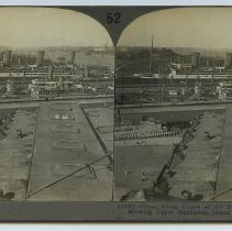 Image of Stereoview: 52 (16762) Great Ocean Liners at the Docks, Hoboken, N.J. Showing Upper Manhattan Island & Hudson River. Keystone View Co. N.d., ca. 1916-1917. - Stereoview