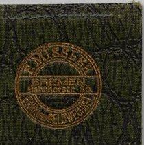 Image of wallet: front cover detail of  stamped F. Missler logo