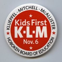 Image of Button: Kids First. K-L-M.  Kluepfel - Mitchell - McAllister. [Hoboken, 2012.]  - Button, Political