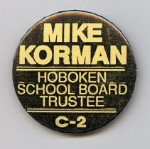Image of Button: Mike Korman. Hoboken School Board Trustee C-2. No date, circa late 1980s or early 1990s. - Button, Political