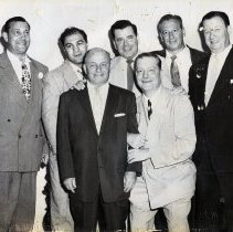 Image of B+W photo of Marty Sinatra, Rocky Marciano, Toots Shor et al, Toots Shor's Restaurant, N.Y. N.d., ca. late 1940s to late 1950s. - Print, Photographic
