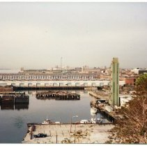 "Image of Color photo of Hoboken southern piers & the ""Big John"", Hoboken, May 1984. - Print, Photographic"