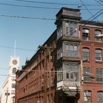 Image of old Keuffel & Esser Co. east building, corner Grand & Third Streets