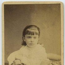 Image of Carte-de-visite of a girl posed in photographer's studio, Hoboken, no date, circa 1875-1890.   - Carte-de-visite