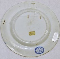 Image of plate - bottom view; staples