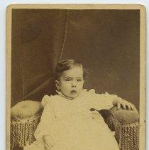 Image of Carte-de-visite of a baby posed in photographer's studio, Hoboken, no date, circa 1875-1890.   - Carte-de-visite