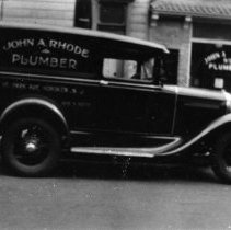 Image of B+W photo negatives of two business photos of John A. Rhode, Plumber, 96 Park Ave., Hoboken. N.d., ca. 1940-1950. - Negative, Roll Film