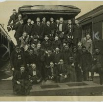 Image of B+W photo of Stevens Institute of Technology students posed at passenger car at Lackawanna Terminal before leaving to break strike, Hoboken, Apr.14, 1920. - Print, Photographic