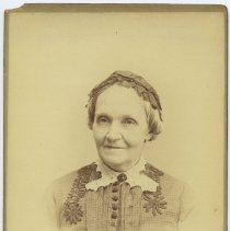 Image of Cabinet photo of Great-Grandma Lancy posed in photographer's studio, n.d., ca. 1888-1892. 