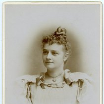 Image of Cabinet photo of a young woman posed in photographer's studio, n.d., ca. 1892-1899.  - Photograph, Cabinet