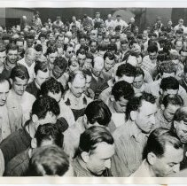 Image of B+W photo of Todd Shipyards workers praying for military forces on D-Day, Hoboken, June 6, 1944.