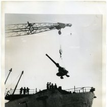 Image of B+W photo of deck gun being lifted off Liberty ship William Wirt at Todd Shipyards, Hoboken, July 16, 1945. - Print, Photographic