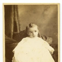 Image of Sepia-tone photo of Liza Fitzpatrick's baby in christening clothes, posed in studio, Hoboken, n.d. ca. 1889-1892. - Carte-de-visite