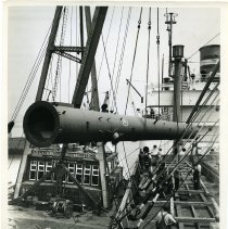 Image of B+W photos, 5, of the loading of industrial fixtures as deck cargo on unidentified Holland America Line ship, Hoboken, n.d., ca. 1947-1952. - Print, Photographic