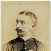 Image of Cabinet photo of man with mustache in military uniform wearing several medal, no date, circa 1885-1890. - Photograph, Cabinet