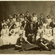 Image of Sepia-tone group photo of 8th grade graduation class of School No. 8; Rose Beck seated at right, Hoboken, n.d., ca. 1910. - Photograph