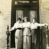 Image of Sepia-tone photos, 2, of Rose Beck, friends & nieces at 600 Madison St. entrance, Hoboken, Spring 1914.  - Photograph