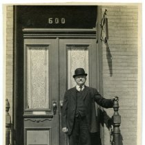 Image of Sepia-tone photo of Karl Beck on front stoop of 600 Madison Street, Hoboken, 1914.  - Photograph